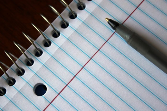 notepad and pen paper keyboard
