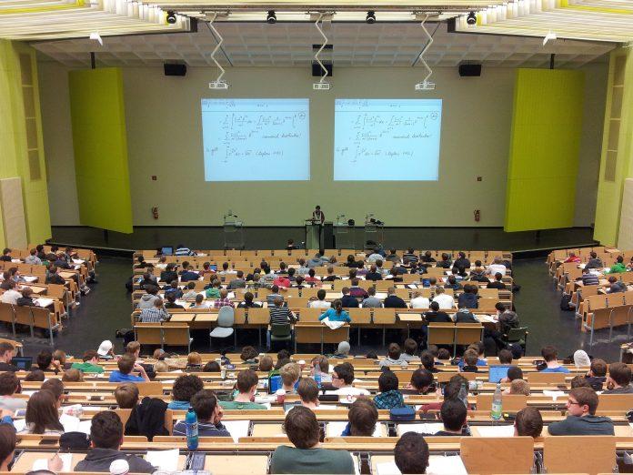 university students sitting in an auditorium