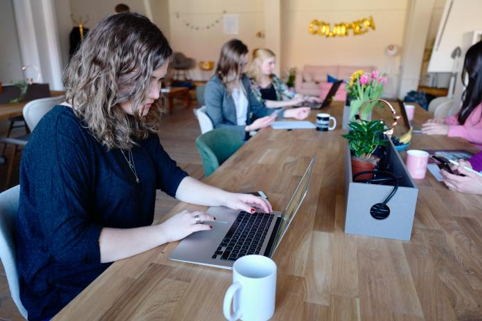 co working space remote working image with women