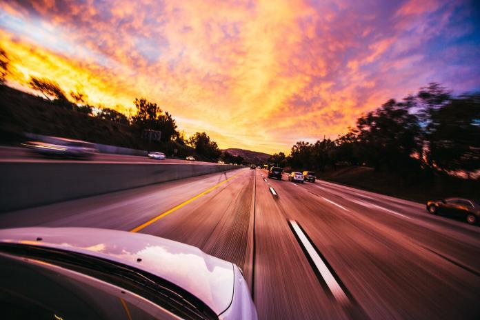 car driving at sunset self driving car