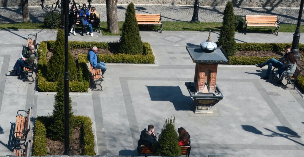 people enjoying sitting in an urban park